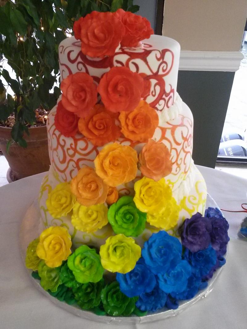 Cascading rainbow wedding cake